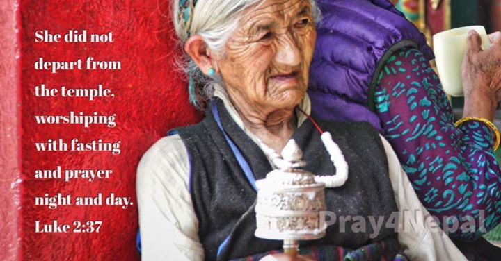 Many elderly Buddhist women in Nepal spend their days in prayer; often at the te…
